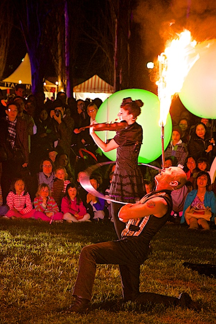 She plays the violin while hula hooping and adds fire!