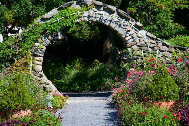 The moon gate entry to the woodland garden